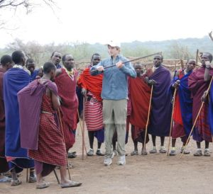 My grandson, Tim, explores the jumping dance with the Maasai.