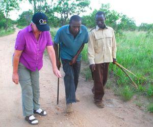Lisa, David and Jacob (left to right) study tracks on our bushwalk near Kikoti.