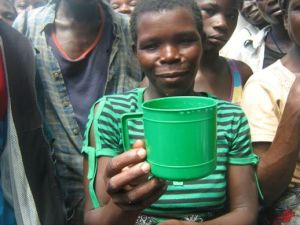 Flood victims in Chikwawa receive one cup of grain per day for their family's sustenance from the aid program that is available.
