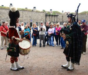 Costumed interpreters in Halifax, Nova Scotia, use music to share history and demonstrate cannon firing.