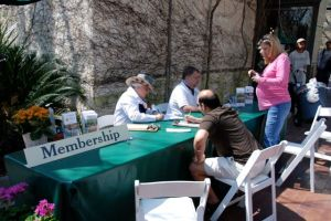 A membership table manned by member volunteers works well at the entrance on high volume days (Dallas Arboretum).