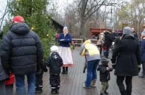 Children learn the Swedish tradition of dancing around the Christmas tree at Skansen, a unique outdoor attraction in Stockholm.