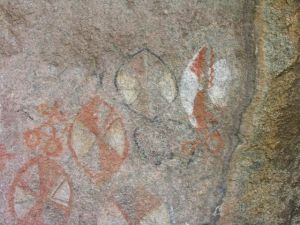 Guides in the Serengeti of Tanzania show cave art where Maasai recorded their sighting of someone on a bicycle.