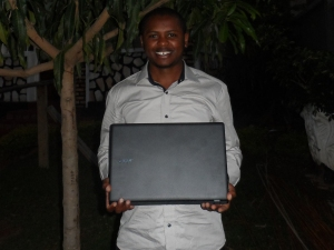 Prudence received his laptop and shared a photo and his thanks to donors.