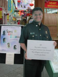 In Singapore they have life-sized posters of local customer service agents with an inviting message.
